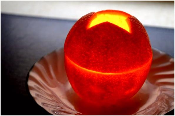 Hoe maak je een kaars van een sinaasappel cadagile