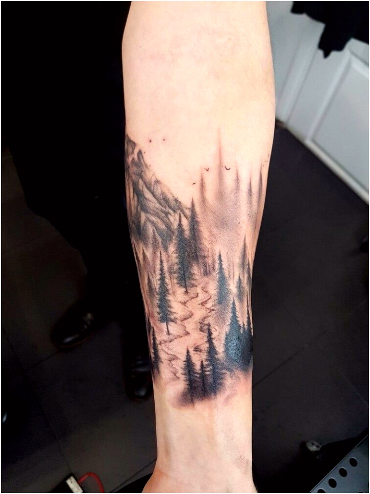 tattoo ink cuff arm trees mountain forest stream